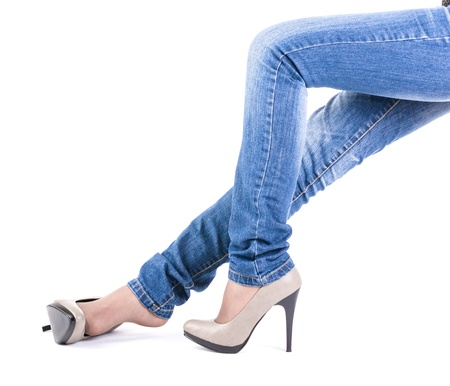 Woman in jeans and shoes resting