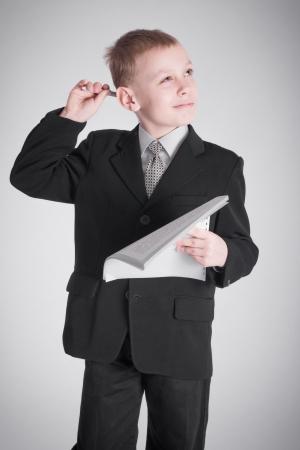 neckties: Boy en un traje negro con una mirada pensativa Foto de archivo