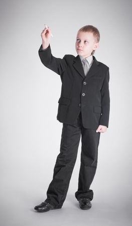 Boy in a black suit writing pen Stock Photo - 19262389