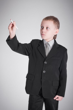 Boy in a black suit writing pen Stock Photo - 19262378