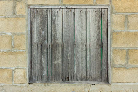 wooden window is very old located in Northern of Thailand photo
