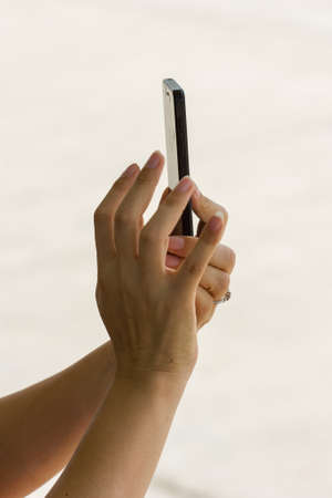 hands of female taking a picture with mobile phone photo