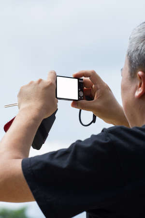 filming point of view: old male taking a picture with camera