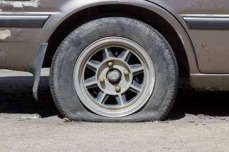 flat tyre in sunshine photo