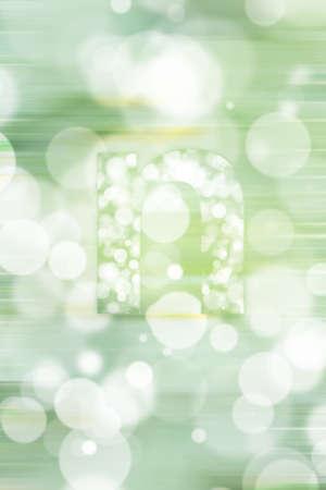 consonant: green bokeh english alphabet background, blured Stock Photo