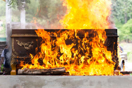 cremation: cremation at graveyard in thailand, coffin burning.