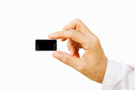 Hand holding very small mobile smart phone with black screen. Isolated on white. concept smart phone becomes smaller. Stock Photo