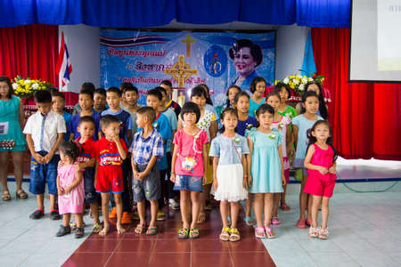CHIANGRAI, THAILAND - AUG 10: unidentified children singing for Her Majesty Queen Sirikit in church on August 10, 2014 in Chiangrai, Thailand. Thai people in every religions always pray for the Queen in the occation of Her Mejesty Queen's Birthday (on Aug