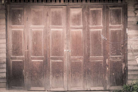 fanlight: vintage wood door of thai style house