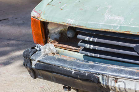 junked: Close up shot of a junked car left in a car park. Stock Photo