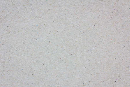 extreme closeup of a grey cardboard texture, background.