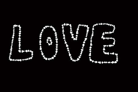 word love made of heart shapes isolated on black background. photo