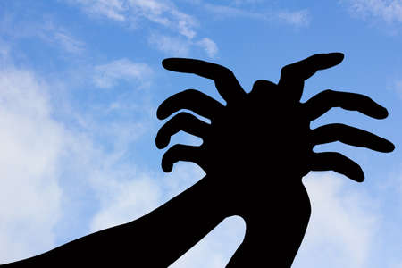spider shape hand silhouette in blue sky and cloud, with copyspace  Zdjęcie Seryjne