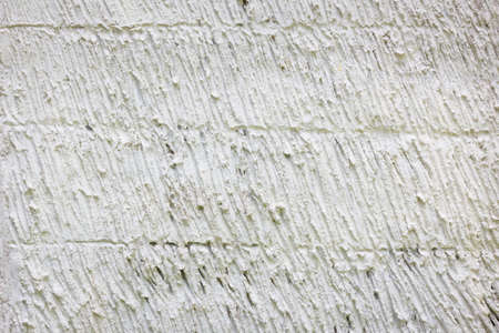 concrete surface finishing: vertical brushed concrete texture as a background.