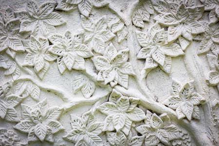 weißem Stuck mit Blumenbeschaffenheit