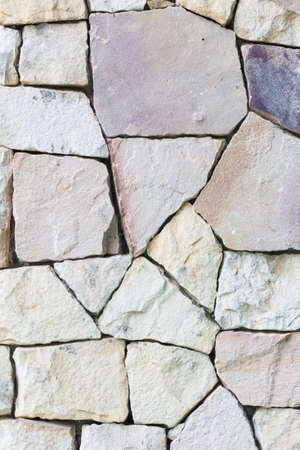 Multi-colored and multi-sized, pale rocks wall grunge texture background. photo