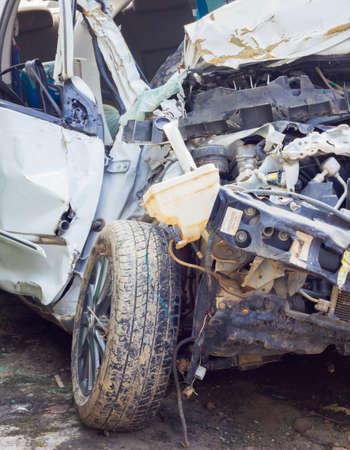 severely: Crashed car close up. The front part is severely damaged, close-up