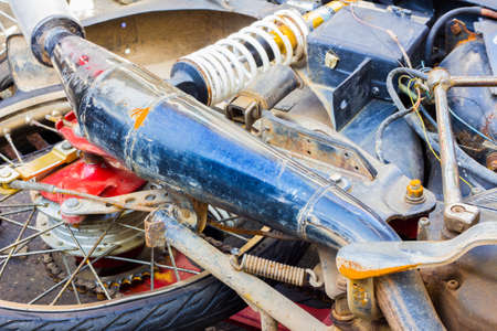 trashed: close-up of broken crashed motorcycle, accident  on the road