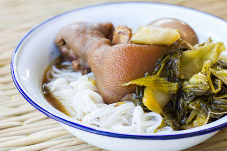 chitterlings: Pork stewed in the sweet gravy, Chinese-Thai cuisine, with thai style spaghetti Stock Photo