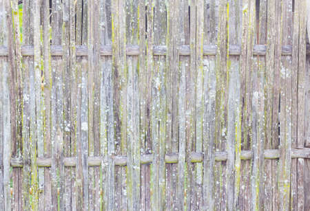 old grungy thai handcraft of bamboo weave pattern fence. photo