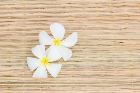 plumerias: White Plumerias on thai traditional mat