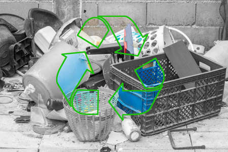 managing waste: black and white plastic garbage with stroke green recycle icon on the middle Stock Photo