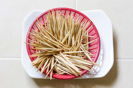 picks: wooden tooth picks in red plastic basket