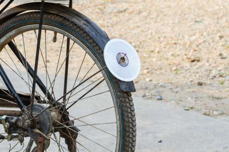 reflector: cd disc on rear mudguard of bicycle, used as reflector, thailand
