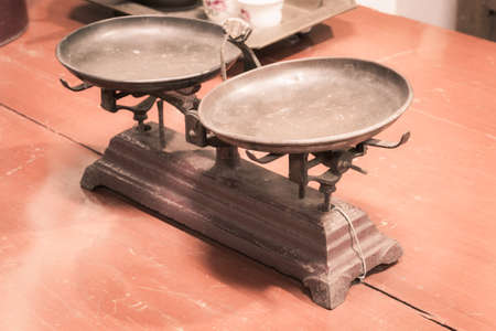 Vintage balance in Thailand, scales, scale on wooden table Stock Photo