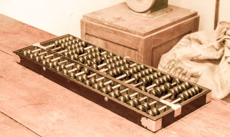 economic revival: Ancient business tool, old abacus with vintage background