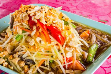 close-up of Green papaya salad called Som-Tum, famous food in thailand photo