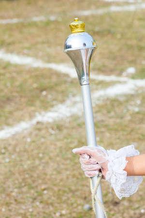 majors: White Gloved Hand Holding Polished Chrome Drum Majors Mace, thailand