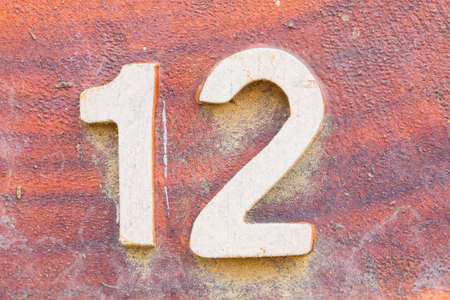 number 12: closeup number 12 on red wooden sign board in thailand