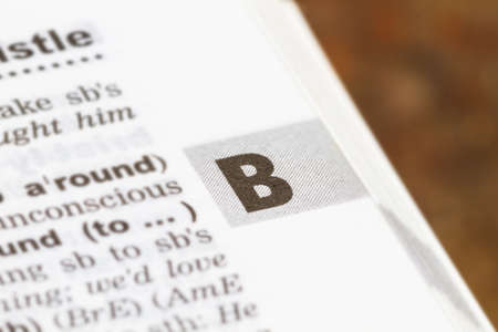 closeup letter B in dictionary, soft focus, Standard-Bild