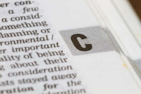 definition define: closeup letter C in dictionary, soft focus,