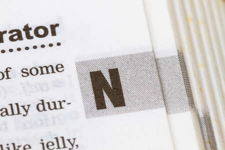 letter word: closeup letter N in dictionary, soft focus, Stock Photo