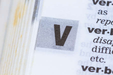 definition define: closeup letter V in dictionary, soft focus,