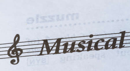 ledger: word Musical on paper in staff and ledger lines