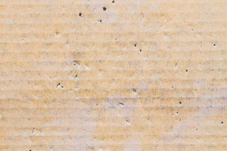 wrinkles: old cardboard texture with creases and wrinkles in certain spots. Stock Photo
