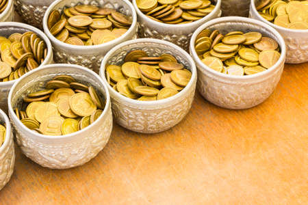 bronze bowl: Coin in bowl for donation, temple of Thailand with copyspace. Stock Photo
