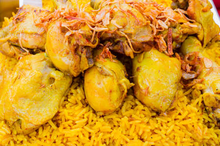 chicken leg: close up Chicken Biryani with green chutney in thai market.