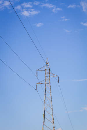 conduction: electrical post by the road with power line cables Stock Photo