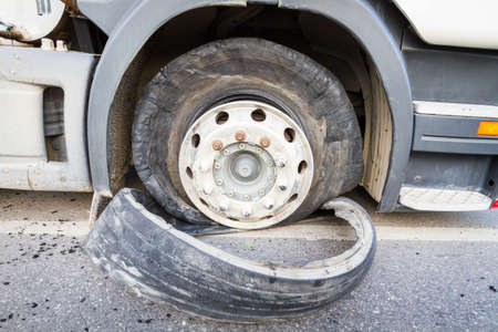 18 wheeler: Damaged 18 wheeler semi truck burst tires by highway street. Stock Photo