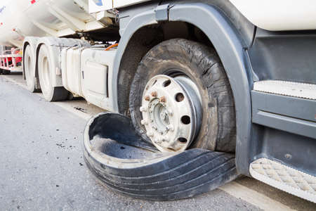 18 wheeler: closeup damaged 18 wheeler semi truck burst tires by highway street