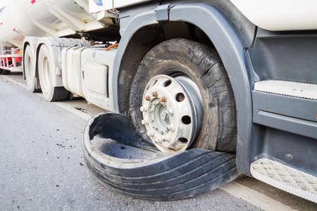 closeup damaged 18 wheeler semi truck burst tires by highway street
