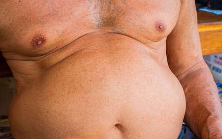 paunch: closeup fat asian man has a big paunch. Stock Photo