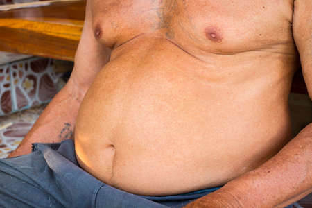 potbellied: closeup fat asian man has a big paunch. Stock Photo