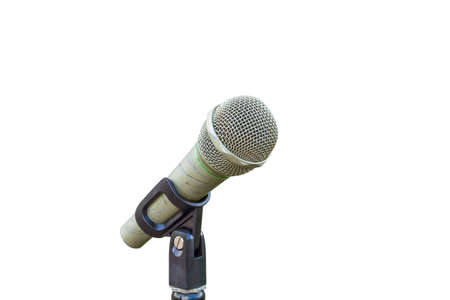 microfono antiguo: old microphone with scratch on handle isolated on white background. Foto de archivo