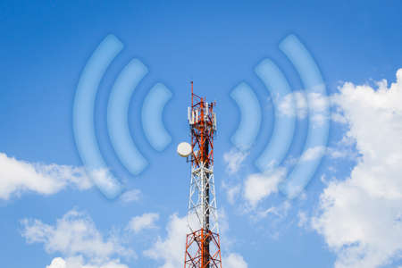 telecommunication tower communication tower with wi-fi wave in cloudy blue sky. Stock Photo