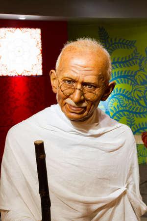 mahatma: BANGKOK, THAILAND - DECEMBER 19: Wax figure of the famous Mahatma Ghandi from Madame Tussauds on December 19, 2015 in Bangkok, Thailand Editorial